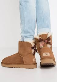 ugg sale uk bailey bow ugg mini bailey bow ii winter boots chestnut zalando co uk