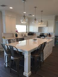 kitchen island as table white shaker waypoint cabinets designed by nathan hoffman