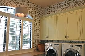 yellow laundry cabinets design ideas