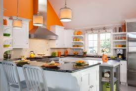 100 beautiful kitchens to inspire your kitchen makeover the m with a bit of orange paint you probably can t go wrong by giving your kitchen an orange focal wall like this covenant kitchens baths inc kitchen
