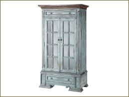 tall distressed wood turquoise storage cabinet with glass doors