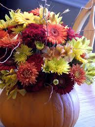 the flower blog fall flowers and a pumpkin