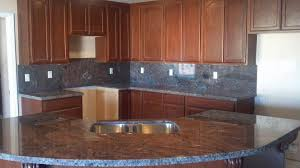granite countertop renewing kitchen cabinets metal backsplash