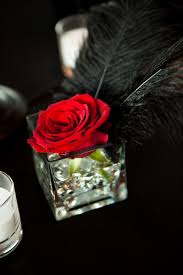 wedding centerpiece singe red rose kind of like the feather