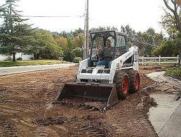 How To Regrade A Backyard How To Grade Soil Using A Bobcat Or Back Hoe Hunker