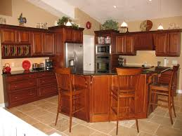 Cabinets Maple Cognac  Countertops Granite Ubatuba - Cognac kitchen cabinets