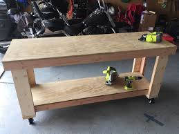 diy garage workbench vhersey vcdx two to the seventh power 128 cut the plywood for the shelf and top attached the shelf and top with the nail gun all done
