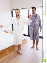 happy couple dancing in bathrobe stock photo image 66093504