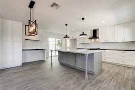 white shaker kitchen cabinets with gray quartz countertops quartz countertops stainless steel appliances wood plank