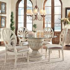 furniture of america sculpture i contemporary glass top round ortanique 5 piece glass top table set by ashley millennium available soon at royal furniture round dining room