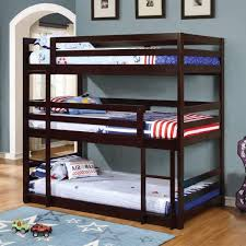 3 bunk beds with stairs for more sleeping space in the room