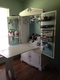 diy craft armoire with fold out table turn a into a tv armoire sewing cabinet sewing room pinterest