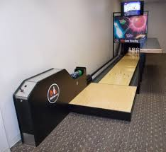 a mini bowling alley in a basement of a regular home the