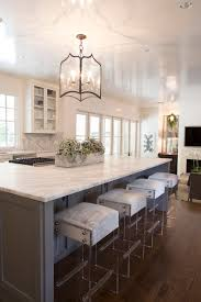 stunning white kitchen with silver lanterns and dark leather