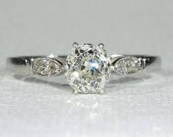 vintage cushion cut diamond platinum solitaire engagement ring