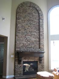 to perform in style to veneer with stone for your stunning captivating arched stone veneer fireplace mantel wall panel idea plus black wood shelf and comfy ottoman