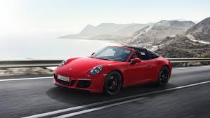 carmine red porsche the new porsche 911 gts models
