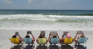 Image result for free image of person reading on the beach