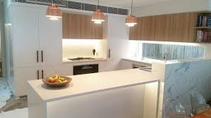 modern kitchen timber floor stone island bench white surprising