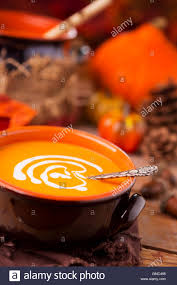 home made fall decorations a bowl of homemade creamy pumpkin soup on a rustic table with