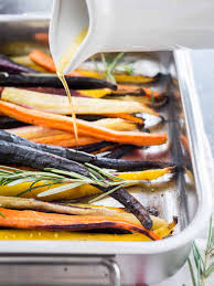 thanksgiving carrot side dish recipe brown butter maple glazed roasted rainbow carrots plated cravings