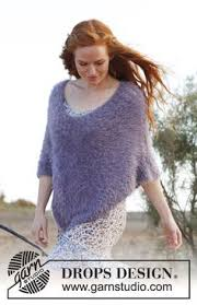drops design poncho free knitting pattern knitted drops poncho in vienna size s