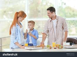 happy family eating pizza kitchen stock photo 484039444 shutterstock