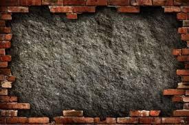grungy dark gray concrete wall in red brick frame conceptual