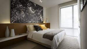 simple modern bedroom simple modern neutral toned bedroom with gray bedcover
