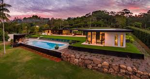 backyard architecture single level family home with a large backyard