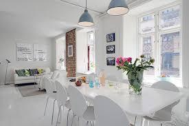 elegant white interior design of a minimalist duplex apartment