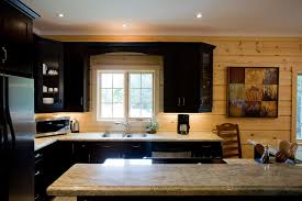 black kitchen cabinets in log cabin top 6 log home kitchen trends for 2021 confederation log