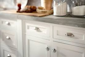 kitchen with custom mosaic glass cabinet hardware uneek knobs for
