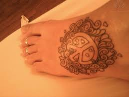 small peace sign tattoo on foot