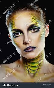 attractive young woman makeup snake shot stock photo 207294832