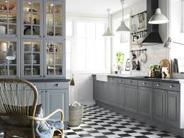 grey kitchen cabinets with white countertops built in ovens dark