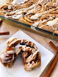 breakfast thanksgiving morning pumpkin spice cinnamon rolls with maple cream cheese glaze three