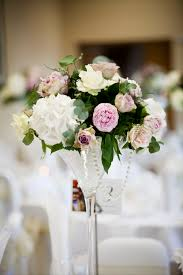 martini purple ivory and pink hydrangeas roses and peonies martini vase centre