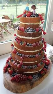 wedding cake with fresh fruits by frizelle cakes chichester