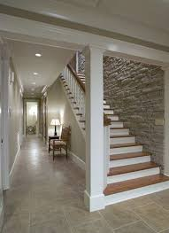 love the stone wall down the basement stairs staircase design