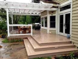 arbor bbq dining area with azek plastic wood deck inset step