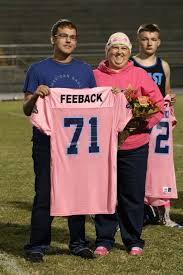 football team honors cancer victims survivors community