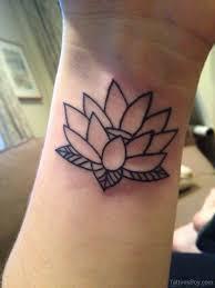 outline lotus flower tattoo on left wrist