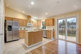 kitchen with light maple cabinets light open concept kitchen room with vaulted ceiling tile floor
