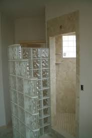 glass block as divider showers room also soft brown granite wall