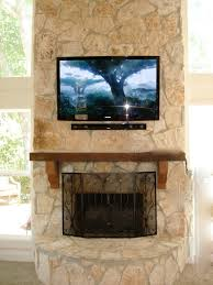 gallery above the fireplace stone tv install houston home
