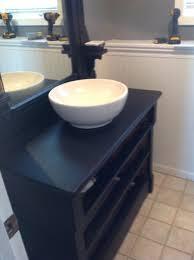 painted wood dresser used for bathroom vanity