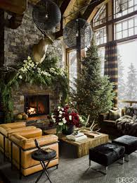 rustic great room with stone fireplace and wall of windows