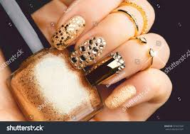 golden nail art manicure holiday style stock photo 551457028