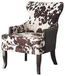 faux cowhide fabric accent chair with stud detail southwestern